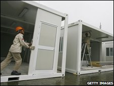 Workers put up mobile classrooms for students from quake-hit areas on August 6, 2008