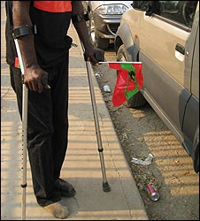 Disabled man on crutches in Luanda