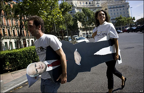 Spanish supporters of John McCain carry a cardboard cut-out of him through Madrid on 4 September