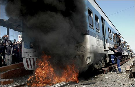 Commuters frustrated by delays set fire to a passenger train in Castelar, Argentina.