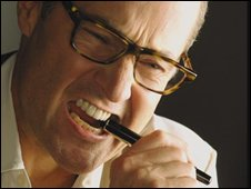 A man chewing on a pen
