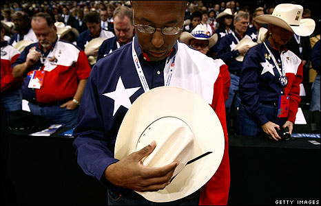 Texas delegates bow their heads at the Republican Convention on 4 September (local time)