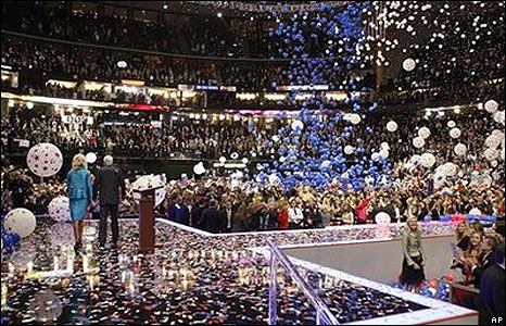 Balloons and confetti rain on John McCain and his wife Cindy