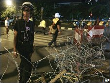 An anti-government protester stands guard outside Government House in Bangkok, Thailand, on Friday Sept 5, 2008.