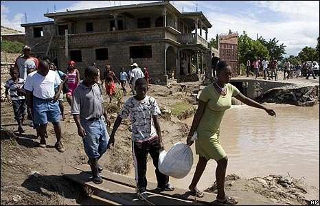 Residents cross a flooded road in Gonaives, Haiti, on 4/9/08