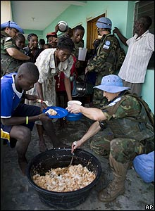 UN peacekeepers hand out food in Gonaives, Haiti, on 4/9/08