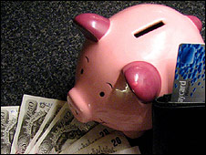 Piggy bank with notes and credit card