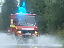 Rescue vehicle on flooded road