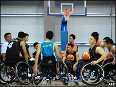 Chinese wheelchair basketball coach Zhai Yongjun (L) rallies his players for a post-training session talk on September 2