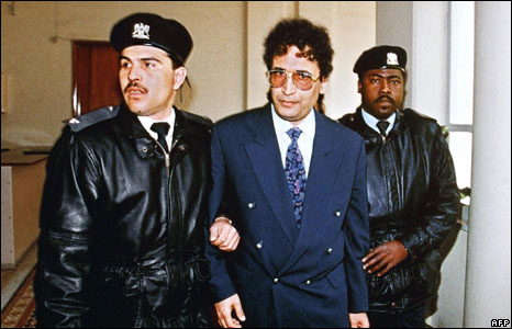 Libyan Abdel Basset Ali Al-Megrahi escorted by security officers before appearing at the Supreme court for a hearing in connection with the 1988 Lockerbie bombing.