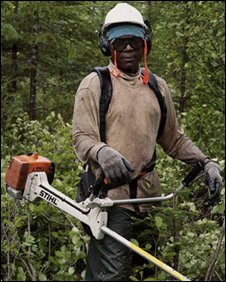 African lumberjack Jean-Pierre Murangira in northern Canada. Photo: Guillaume Simoneau