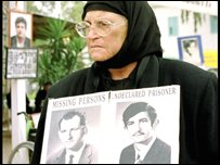A Greek-Cypriot woman holds a picture of relatives missing since the Turkish invasion of Cyprus in 1974.