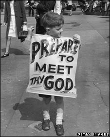 Child holds placard