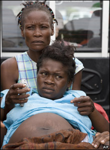 A pregnant woman in labour arrives at a UN base in Gonaives, Haiti