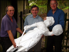 Bob Pirie (right) and members of the project team with the figurehead