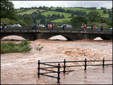People look at the flooded river  Usk in Brecon (Picture; Steve Thomas)