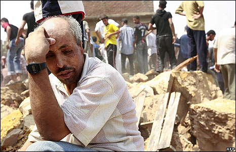 Distraught man in wreckage of homes
