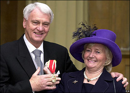 Sir Bobby Robson as he receives a knighthood at Buckingham Palace accompanied by his wife Elsie