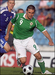 Healy brings the ball forward for Northern Ireland
