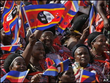 People wave the National flag of Swaziland
