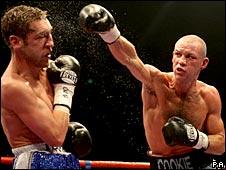 Nicky Cook hitting Alex Arthur