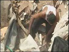 A man combs through the rubble in Cairo