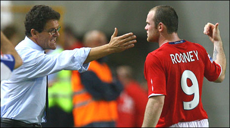 Fabio Capello (left) gets his point across to Wayne Rooney