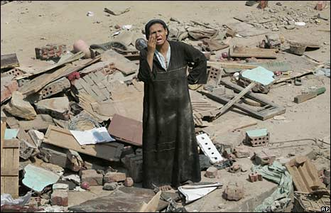 A woman stands amongst the rubble in Cairo. Photo: 7 September 2008