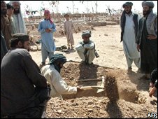 Graves being prepared Azizabad for people killed in last month's attack by US forces