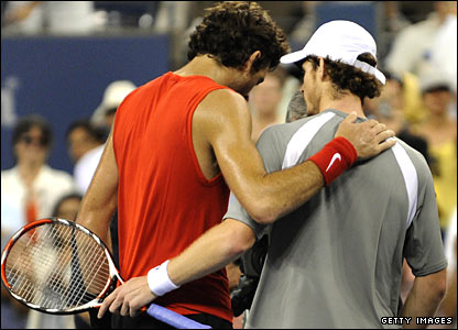 Andy Murray (right) shares a moment with Juan Martin del Potro after their match
