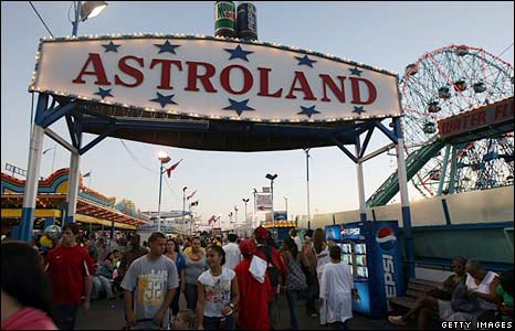 Visitors walk on the final day of operation of Astroland on 7 September 2008