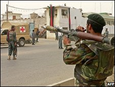 Afghan National Army (ANA) soldiers and policemen stand guard at the site of two suicide attacks in Kandahar on September 7, 2008
