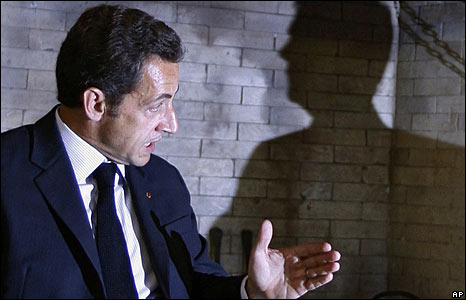 French President Nicolas Sarkozy in Moscow with Russian President Dmitry Medvedev, who is seen in shadow on the right
