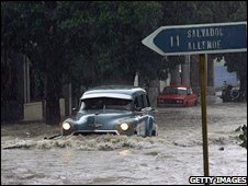 A car along a flooded street in Havana