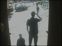 CCTV shows supporters approaching the bar
