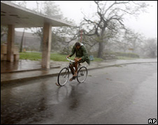 Man rides his bicycle amid rain brought by Hurricane Ike in Camaguey, Cuba