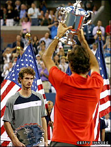 Andy Murray looks on as Roger Federer lifts the US open trophy