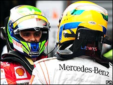 Felipe Massa and Lewis Hamilton shake hands after the Belgian Grand Prix