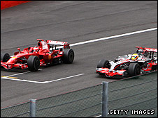 Ferrari's Kimi Raikkonen and Lewis Hamilton of McLaren dispute the lead during the Belgian Grand Prix