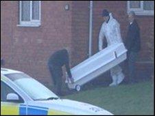 Police remove the body of Philip Marsden