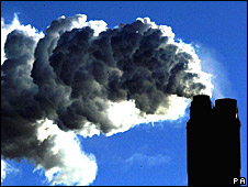 Smoke pours from a power station chimney