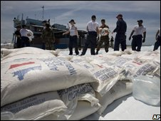 US Navy personnel unload supplies to provide disaster relief support following Hurricane Ike in Gonaives