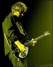 Peter Buck with his Rickenbacker guitar. (Photo: REM website)