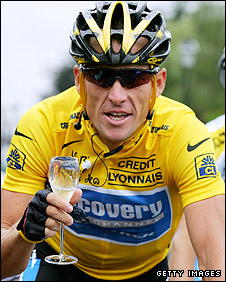 Armstrong of the USA has a glass of champagne on his way to winning a seventh consecutive Tour de France in 2005