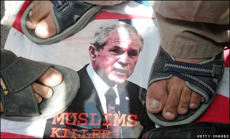 Pakistani protesters step on a poster of US President Bush at Multan on 10 September 2008