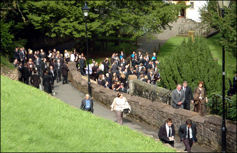 Friends and family of the couple come out of Llandaff Cathedral at the end of the funeral.