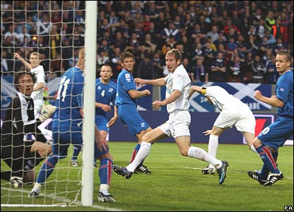 Kirk Broadfoot (centre) scores for Scotland