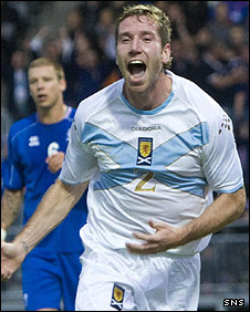 Kirk Broadfoot celebrates his first half goal in Reykjavik