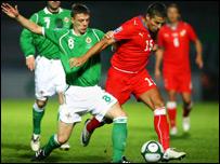 Chris Baird challenges Czech striker Milan Baros in Belfast