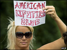 "A McCain supporter holding a banner that reads ""American Lipstick Club"""